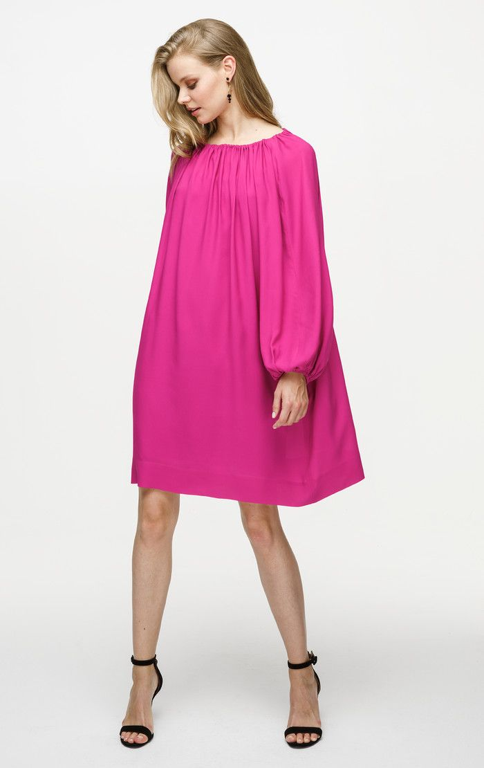 This tunic dress has a drawstring neckline that creates a flattering ruched effect. Made of fluid crepe de chine, this style has a loose silhouette with puffed sleeves for a luxe bohemian feel.