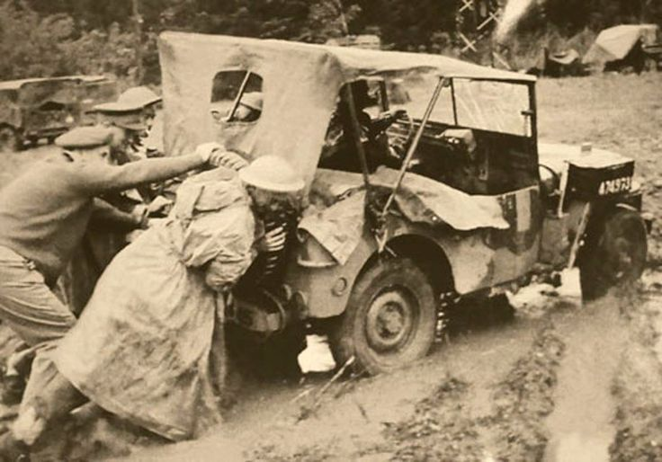 6th South African Armoured Division soldiers pushing jeep somewhere in Europe, 1944