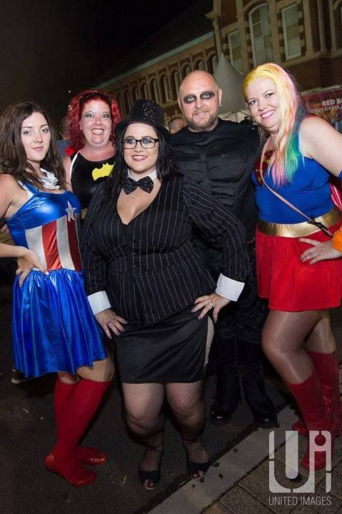 Great shot of Miss Captain America, Bat girl, Batman, Mrs Penguin and Supergirl at the MG after party!