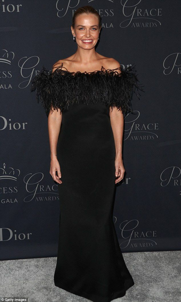 Royally radiant! Lara Bingle STUNS in striking black gown adorned with feathers at the Pri...