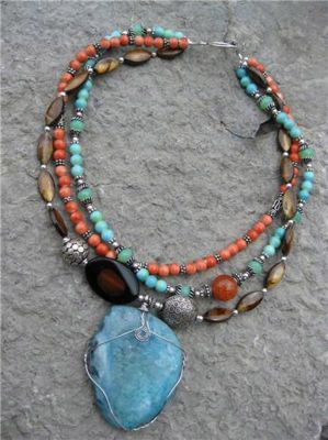 Mayan Breastplate Necklace -earth-tone beads & stones add elements of nature to this multi-layered necklace.