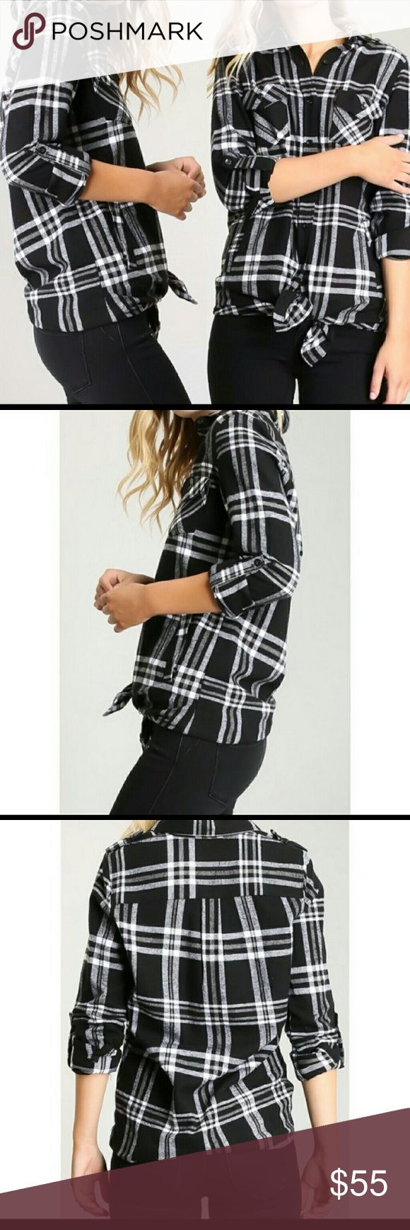 Plaid Top @blushonme at Poshmark   Plaid Top - Navy/Ivory  NOTE - Stock photos used to show similar style. Actual item is in pictures 4&5.  Plaid is in ladies. This cute top has a thin, soft material with two front pockets,  sleeve fold button closure.  100% Polyester Tops Button Down Shirts