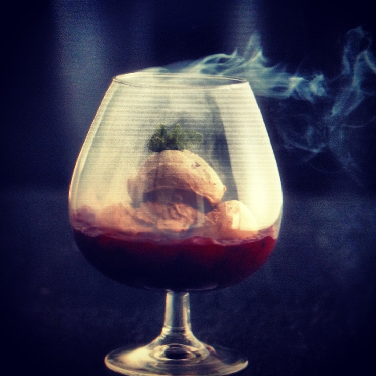 Smoked chocolate ice cream with cherry compote