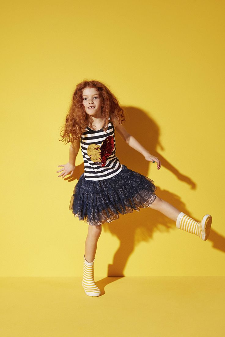 Dress with nautical stripes in Desigual's style and a heart made of reversible sequins that change color when you pass your hand over them.