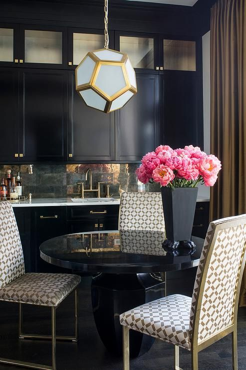 Gold And Black Dining Room Features A Robert Abbey Mary Mcdonald Pythagoras Pendant Illuminating Round
