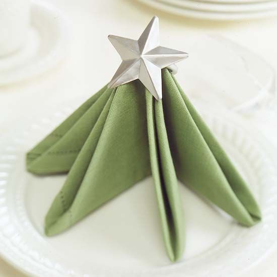 Star-Top Tree Napkin...like this, especially if I made the star a party favor ornament or jewelry in glass, metal or wood!?! Or you could have the guest name on it for seat markers.