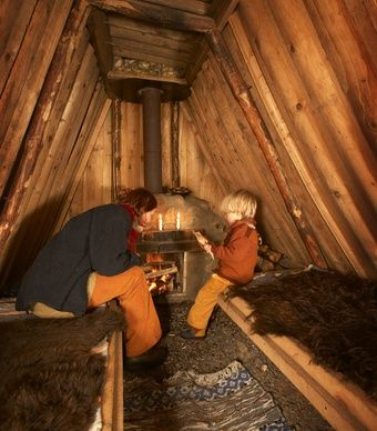 Sweden's Kolarbyn - primitive eco lodges. Inside one of 12 primitive forest huts here, candles and fireplaces provide the only night-lights, and guests cook their own meals over an open fire.