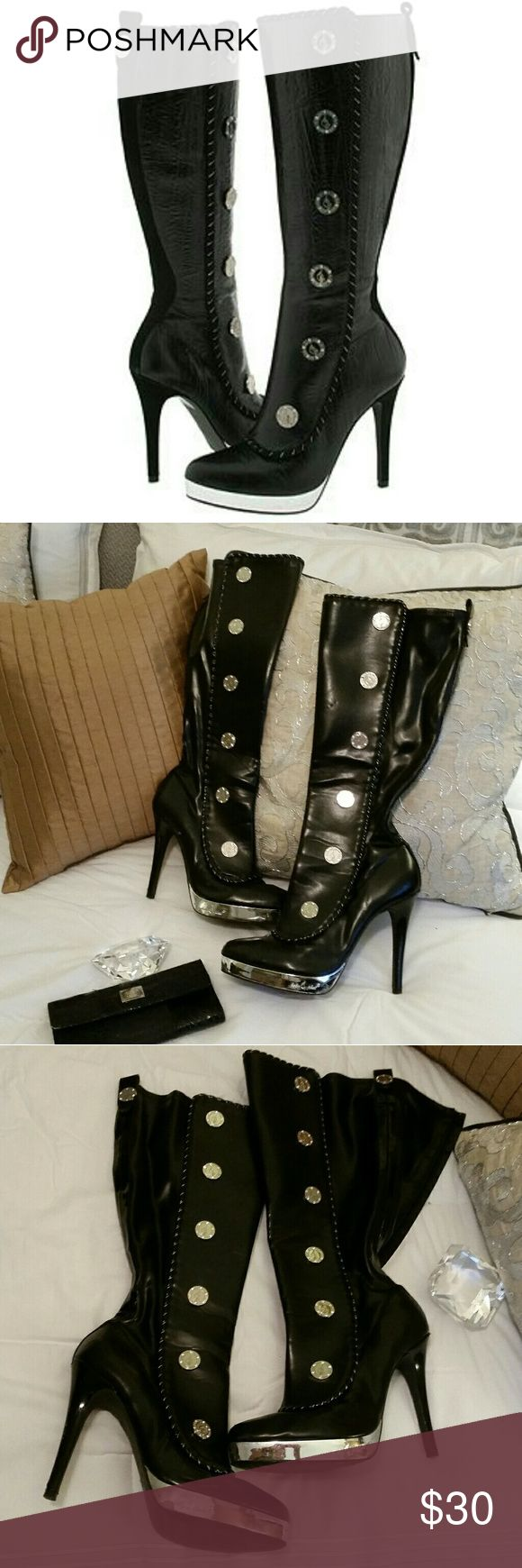 Fabulous Baby Phat Moscow Boots!! 💖 Fabulous Baby Phat Moscow boots!! Faux leather with gorgeous silver decals up the exterior and on back. These boots are pre-loved with some scuffs and wear, but overall they are still in decent condition. Baby Phat Shoes Heeled Boots