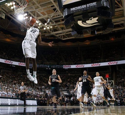 Michigan State's Branden Dawson dunks during the second half of an NCAA college basketball game against Purdue, Saturday, Jan. 21, 2012, in East Lansing, Mich. Michigan State won 83-58. (AP Photo/Al Goldis)
