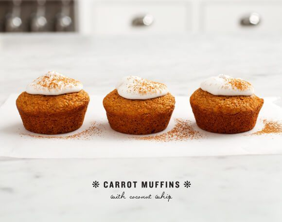 Healthy non-dairy muffins packed with carrots and topped with coconut whipped cream.