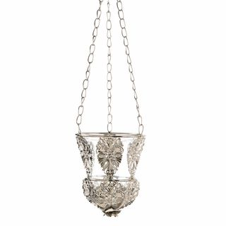 $24.95 - Create an elegant ambiance instantly when you place a candle inside this gorgeous and ornate hanging holder. Delicate silver filigree ornaments grace a beautiful glass candle cup that's rimmed with silver and hangs from three chains.
