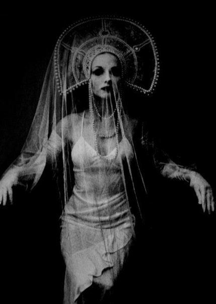 """Selfportrait, Irina Ionesco (b. 1935)    """"…her pictures of women, with their pallid complexions and statuesque poses, often suggest death. 'Yes. I didn't set out to do this — it happened. It is more than death, it is mainly the waiting. It is an image of loneliness. Loneliness and death are almost the same thing.""""     ~quoted from 'How to Photograph Women' by Dixons    blog: The Witch and the Wardrobe"""
