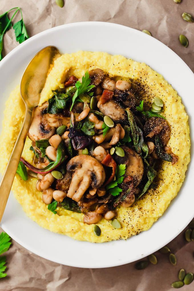 This Creamy Vegan Polenta with Mushrooms and Beans is an easy 30-minute dinner packed with whole grains, plant protein, and vegetables. #veganDishes