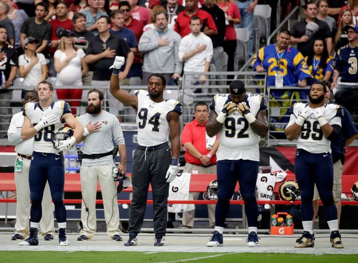 Rams vs. Cardinals Updated October 2, 2016:  17-13, Rams  -     Los Angeles Rams defensive end Robert Quinn (94) raises his first during the national anthem prior to an NFL football game against the Arizona Cardinals, Sunday, Oct. 2, 2016, in Glendale, Ariz.