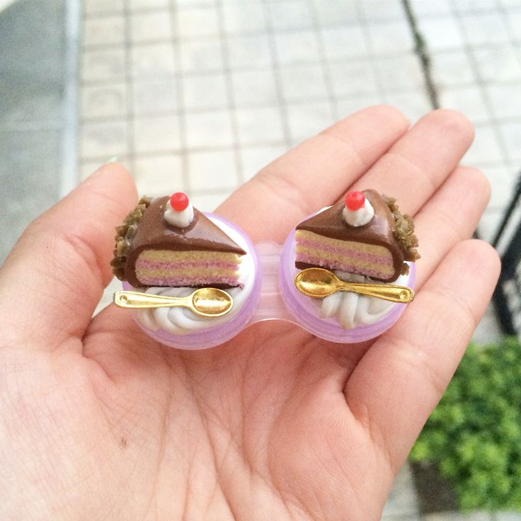 Contacts lenses case with piece of cake on with their little gold spoons all placed on fake frosting!  #SweetsnPearls #contactlenses  ✔️www.sweetsnpearls.etsy.com