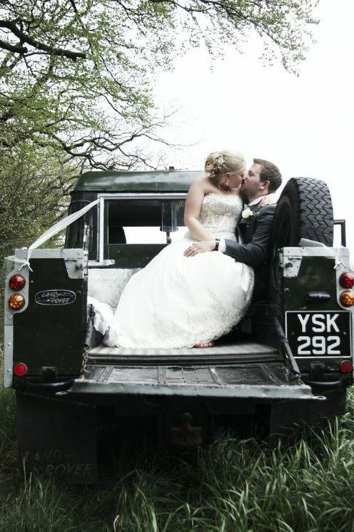 Romantic Land Rover wedding kiss