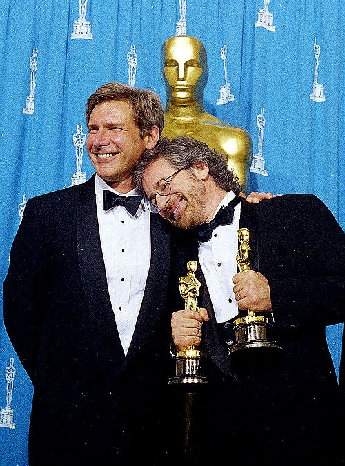 """1994: Harrison Ford and Steven Spielberg at the 66th Academy Awards. Spielberg took home 2 Oscars in the categories of Best Director and Best Picture for """"Schindler's List""""."""