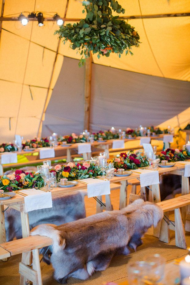 Gorgeous Tipi wedding decor with lots of flowers, greenery and fur  | onefabday.com