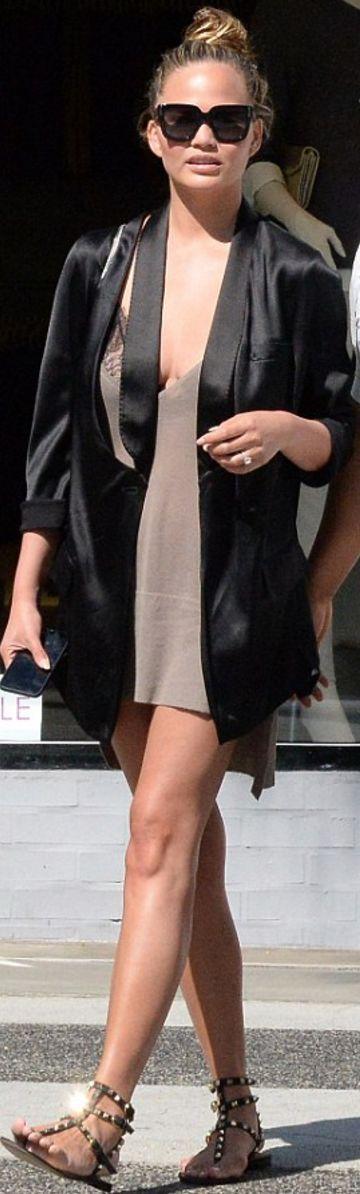 Chrissy Teigen: Purse – Saint Laurent  Shoes – Valentino  Jacket and sunglasses – Givenchy