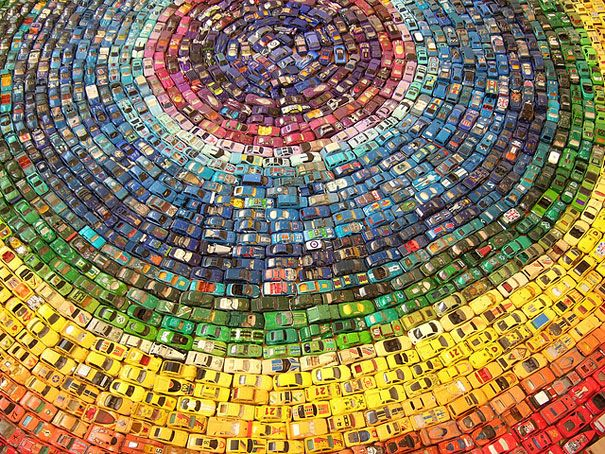 UK-based artist  David T. Waller used 2,500 toy cards to create this beautiful and colorful installation piece titled Car Atlas.