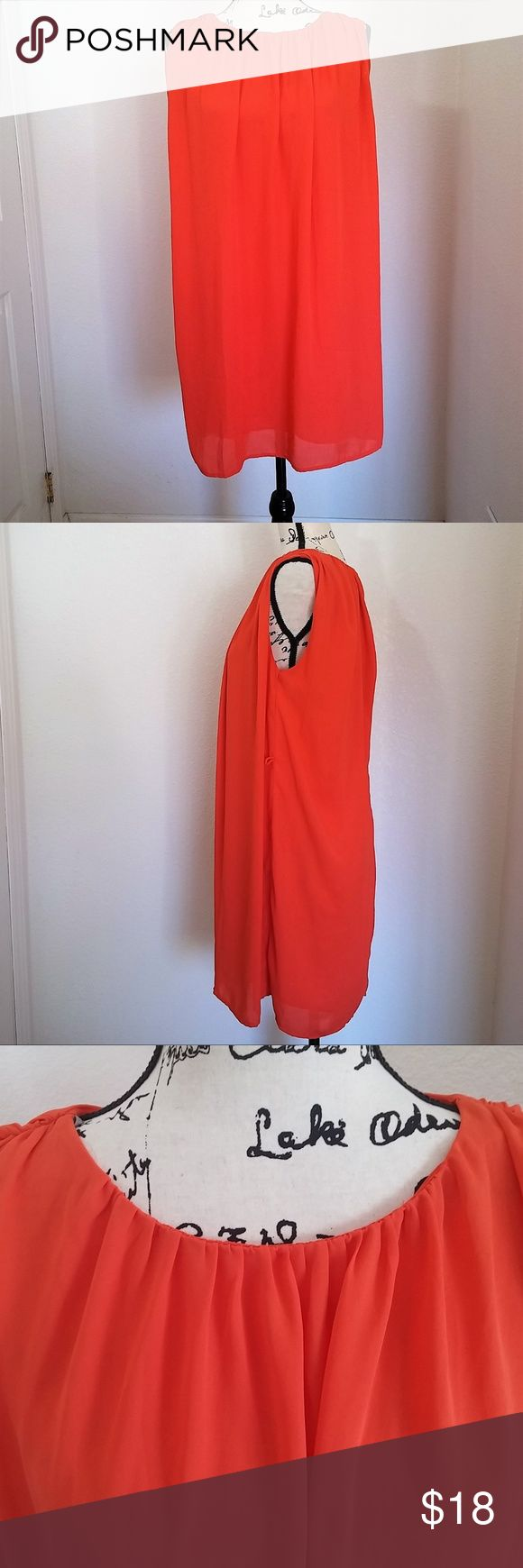 """sz XS Forever 21 orange chiffon sleeveless dress Forever 21 orange chiffon sleeveless dress. Pleated scoop neck. Fully lined. Hand wash.  Note - belt is not included.   Size XS - 30"""" length, 15"""" shoulder to shoulder, 20"""" chest  See photos for details. Smoke free, pet friendly home.   Please message me with any questions. Ask if additional size detail is needed.   15% discount for 3+ item bundles. Check out my closet. Happy Poshing!  665/CR Forever 21 Dresses"""