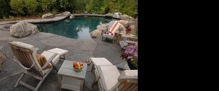 Backyard Oasis- concrete pool with granite rocks