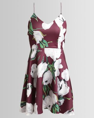 Treat your wardrobe to AX Paris\' Strappy Floral Skater Dress. This dress is cut in a universally flattering fit and flare silhouette and decorated with beautiful blooming flowers for a trendy finish. Style yours with strappy heels or white low-top sneakers for a skater-chick look.