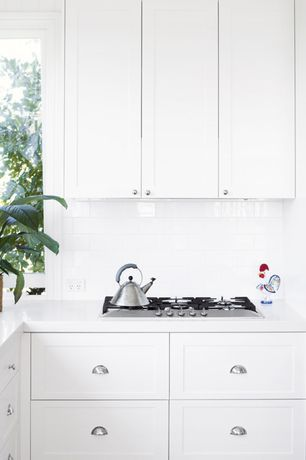 Traditional Kitchen with Limestone Tile, Coconut Oil Laminate, Hickory Hardware Williamsburg 3 in. Cup Pull, High ceiling