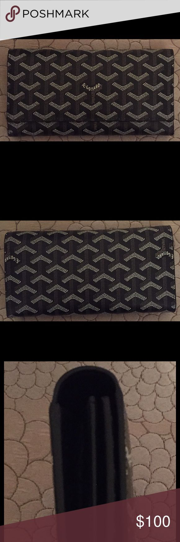 ✨✨✨Goyard Black Wallet✨✨✨ This Goyard wallet is beautiful✨✨✨!!! It's black with yellow interior, has a lot of credit card slots, room for checkbook, cash, coin, etc... I've only used about 3 times. It's in excellent condition. Price reflects authenticity. THIS IS NOT AUTHENTIC!!! It is very good quality 1:1. The pictures in post are of all sides of the wallet inside and out. Wallet is very clean and from smoke/pet free home. Goyard Bags Wallets