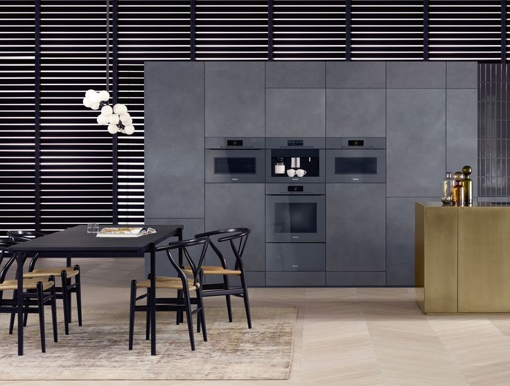 Miele's ArtLine appliances in graphite grey are the perfect choice for a handleless kitchen - in place of a handle, there is a sensor integrated into the fascia (Touch2Open) of the oven, steam oven or microwave combination oven, and by gently touching or lightly tapping the sensor, the motor-assisted door will glide open