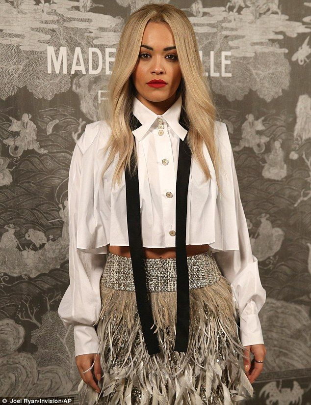 Tonally terrific: The combination of white, black and glittering grey was the perfect look for Rita, who usually opts for sexier, more urban styles