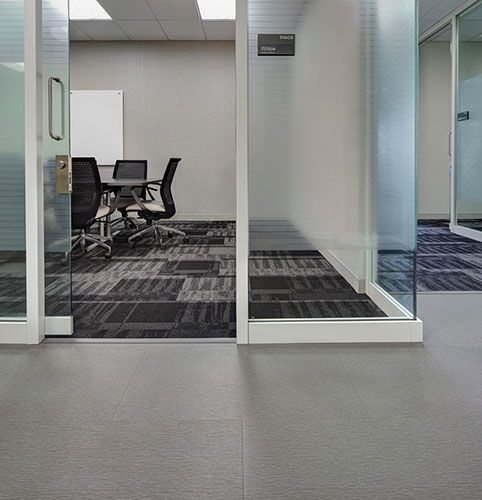 Abstract Twist LVT In A Crisp Neutral Is Balanced With Sound And Fury Cushion Backed Medical CollegeCollege OfWisconsinTwistsCarpets