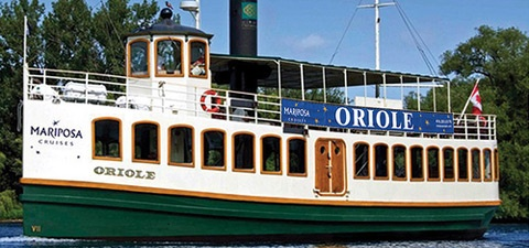 """Oriole"" is a beautifully elegant ship. Impress your corporate guests with its varnished woods, wrought iron, polished brass and plush upholstery."