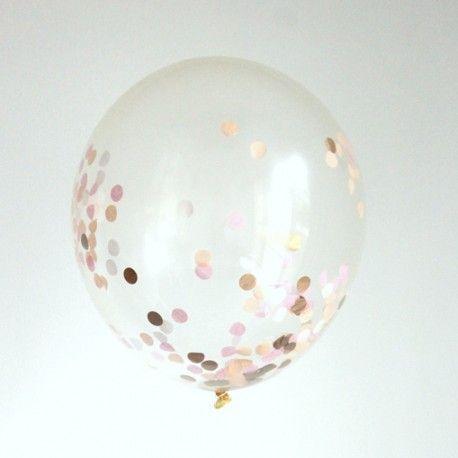 Grand ballon rempli de  confettis pêche, rose poudré, rose foncé et cuivre