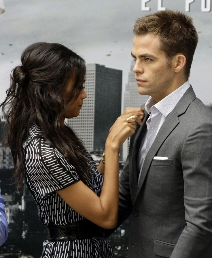 Zoe Saldana and Chris Pine. Is our just me or does everyone like adjusting his tie?