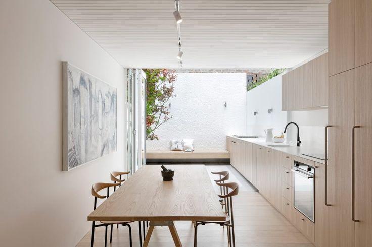 Worktop extends from kitchen to garden in Sydney residence by Benn + Penna Architecture