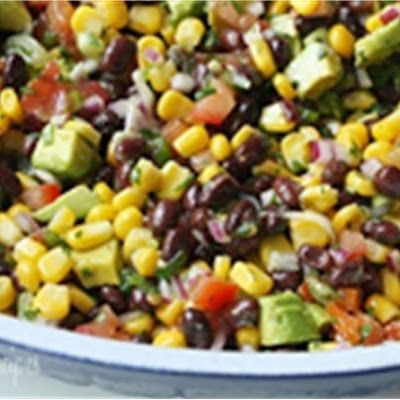 black bean salad/salsa thing, made a great dinner.  I put tortilla chips in the oven and melted cheese over them and we all just scooped it up and ate it that way. With parchment paper on the cookie sheet, no cleanup.