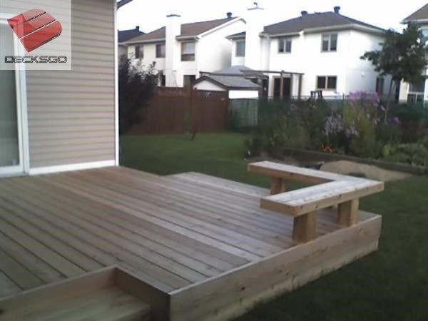 An inside corner cedar deck with a bench