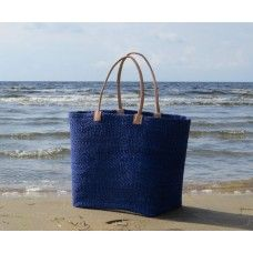 Fair Trade basket. Handcrafted of woven sisal and reeds. Leather handles.