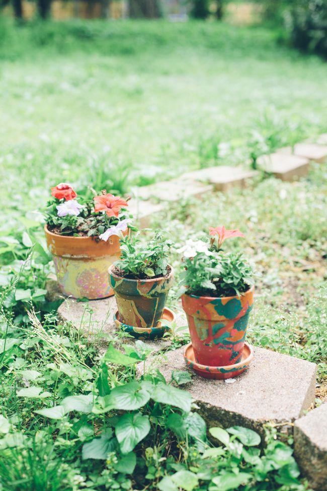 Nail Polish Marbled DIY planters | http://helloglow.co/diy-planters-with-nail-polish/