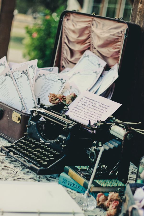 Love the suitcase with the programs, and the typewriter..I envision a note to the guests in the typewriter.