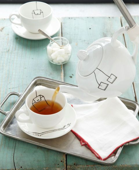 This witty set starts with plain ceramic dishes (for similar cup and saucer set, $4.99, and teapot, $9.89; englishteastore.com). To get the show on the road, freehand the tea bag, tag, and spoon designs, using our image as a guide, with Pebeo's Porcelaine fine-point marker ($4.82; dickblick.com). Don't worry if you make a mistake — the ink can be washed away for up to 72 hours. Allow at least 24 hours' drying time, then bake the items for 35 minutes in a 300°F oven. Let cool completely, and…