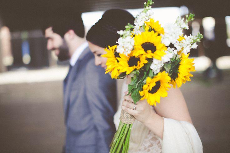 Creative wedding photography - music themed wedding - hippie wedding - sunflower bouquet - love fest - alternative wedding venue - Old Rock House - St Louis - Hawes Photography