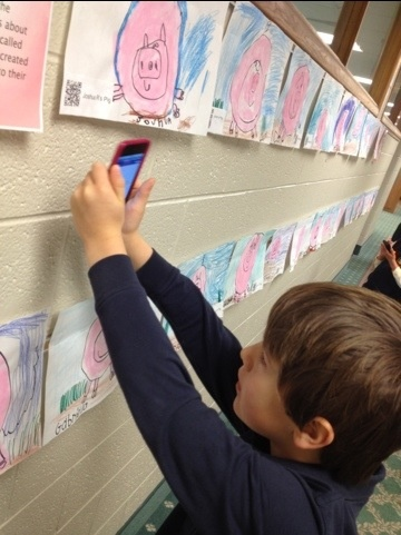 Use the app Audioboo to create artist statements then link to QR codes and scan with mobile devices.