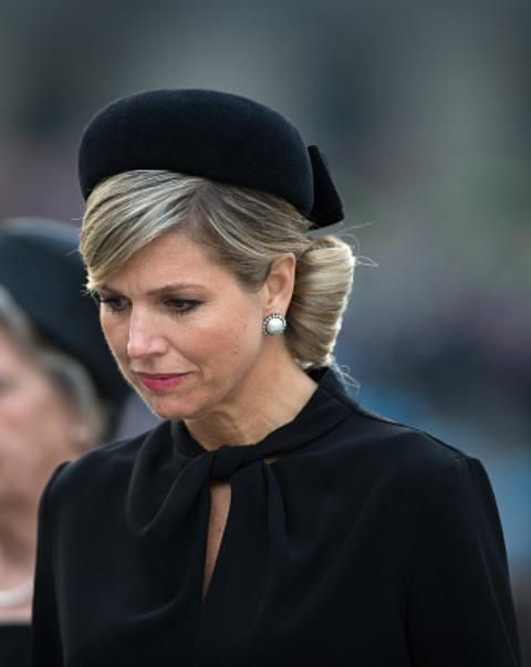 Queen Maxima of The Netherlands walks during a defile at the National War Memorial during a remembrance gathering on Remembrance Day on May 4, 2015 in Amsterdam, Netherlands.