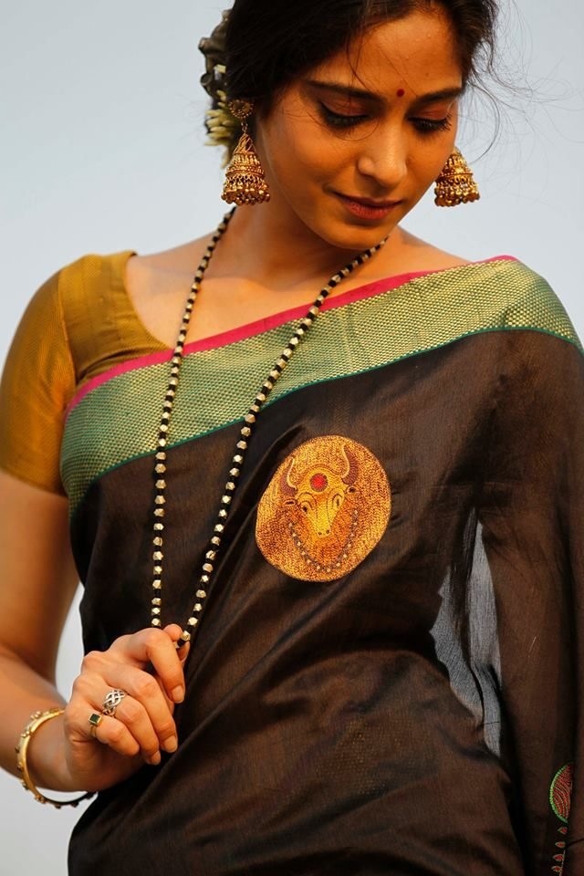 A black Maheshwari Saree. Single thread hand embroidered Bull Motif. Queen of Hearts by Deepa Mehta