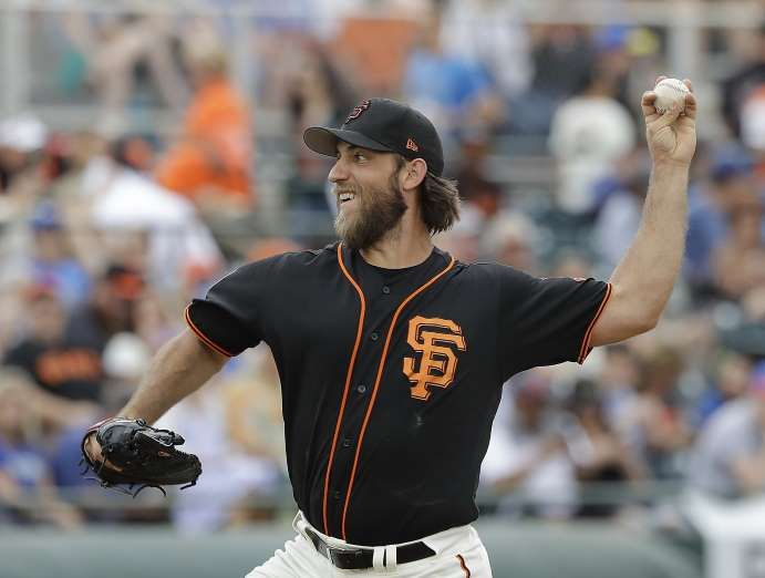 Giants-Dodgers tickets plunge to $6 after brutal start  -  April 24, 2017:   San Francisco Giants' Madison Bumgarner throws during the first inning of a spring training baseball game against the Kansas City Royals, Sunday, March 5, 2017, in Scottsdale, Ariz. (AP Photo/Darron Cummings)