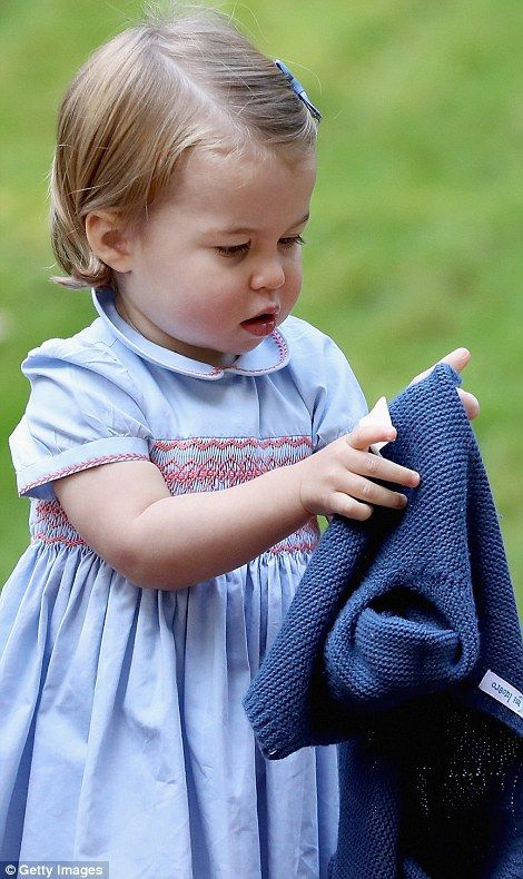 Showing how independent she has become, Charlotte took the cardigan from her mother...