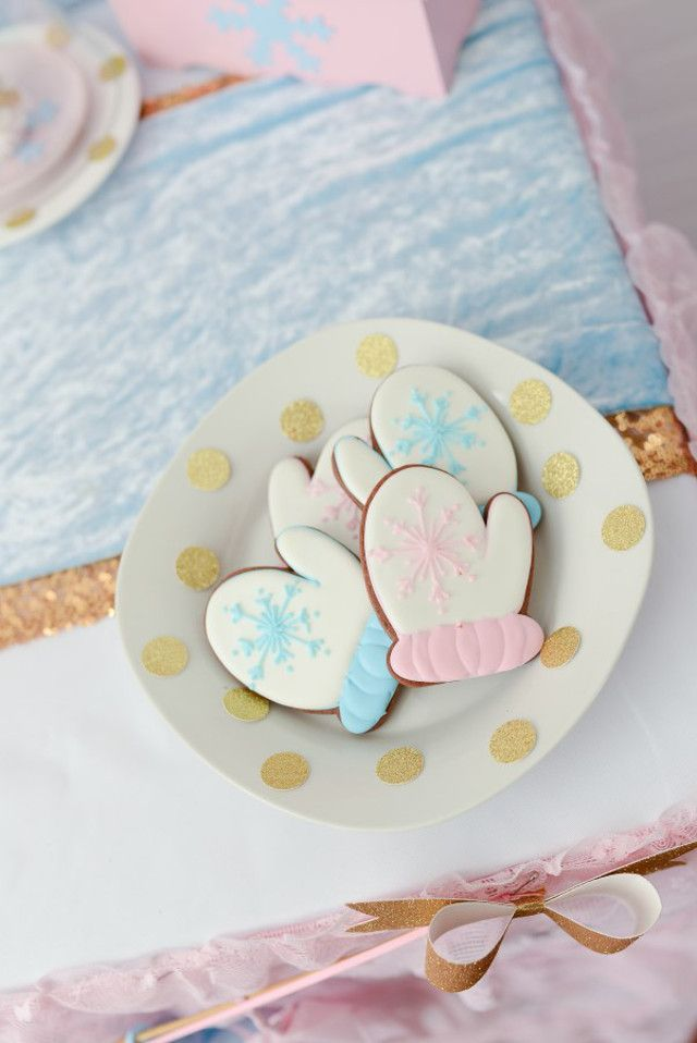 pink and blue mitten cookies for a christmas / holiday cookie baking party by Sweetly Chic Events