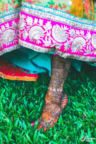 Indian Wedding Photography - Aqua and Pink Floral Lehenga with a Mehendi Foot Shot | WedMeGood #wedmegood #lehenga #indianbride #indianwedding #mehendi #mehendishot #mehendidesign #bridal Picture Courtesy : The Cheesecake Project